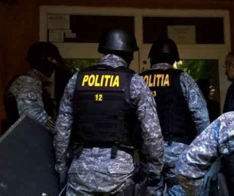 Percheziții uriașe. Polițiștii răscolesc Bucureștiul și 20 de județe. Ce caută