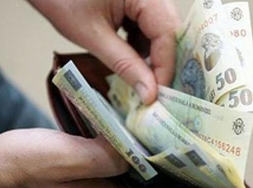 Lovitură cruntă pentru români. Dispare salariul minim?! Cum se vor da banii
